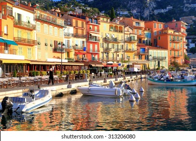 Colorful buildings with traditional architecture near the harbor of Villefranche sur Mer, French Riviera, France