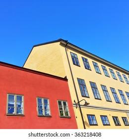 Colorful buildings under blue sky. Center of Stockholm, Sweden.