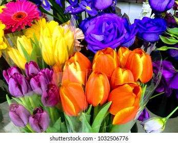 Colorful bunches of flowers at market