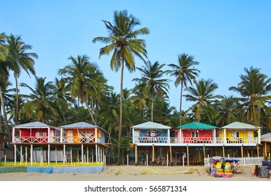 Colorful bungalows on the tropical beach of Palolem, South Goa, India