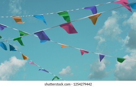 Colorful bunting flags against blue sky