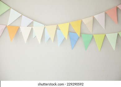 colorful buntings on wall, green, red, yellow, blue and white