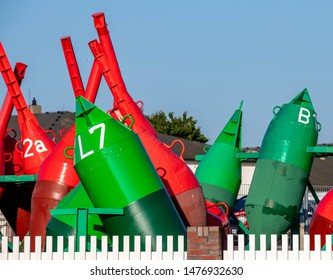 colorful buoys in norderney germany, ferry sign transportation