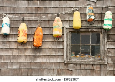 Colorful buoys on the old house in Peggys Cove, Nova Scotia
