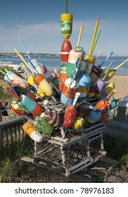 Colorful buoys stacked together on top of a lobster trap