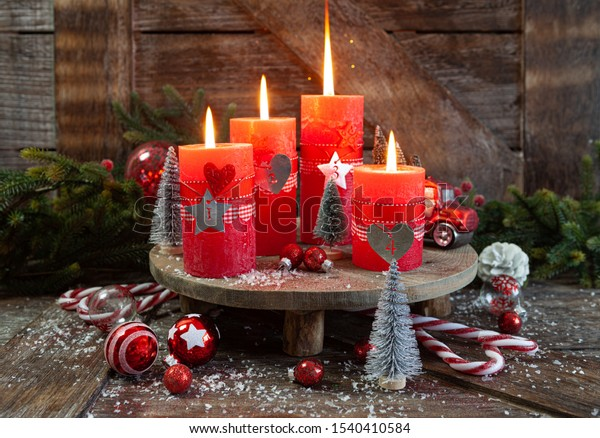 Colorful burning candles and festive decorations for Christmas