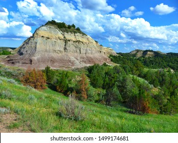 A colorful butte rises from the badland landscape of North Dakota's Theodore Roosevelt National Park.