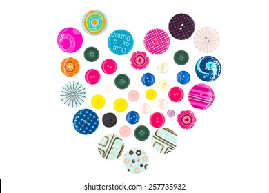 Colorful buttons as heart shape on white background