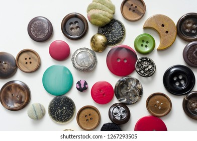 Lot Of Colorful Buttons on White Wooden Table, close up