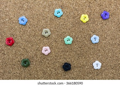 Colorful buttons on a wooden background./ Colorful buttons