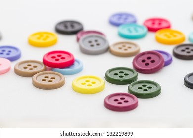 Colorful buttons spread on white background