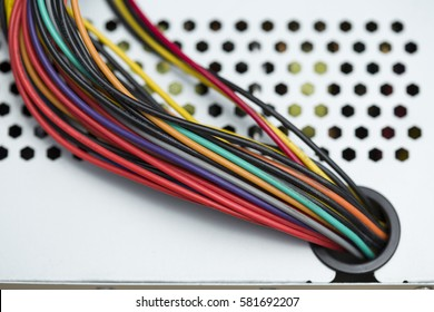 Colorful cables and a metal box