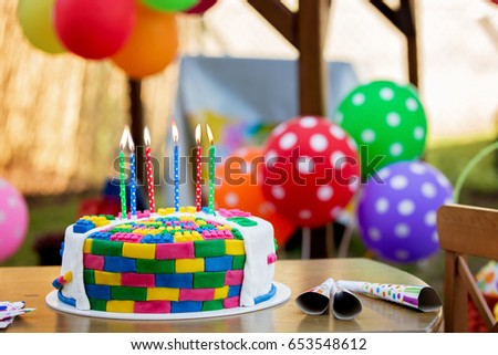 Colorful Cake With Candles And Balloons For A Childs 6th Birthday Party