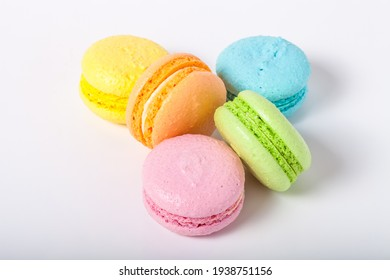 Colorful cake macaroons on a light background.