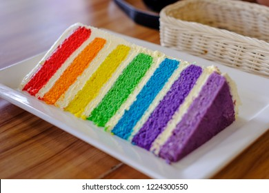Colorful cakes are divided into layers. Called Rainbow Cake Sweet and sour taste of cream cheese