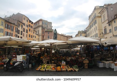 Colorful Campo de Fiori street market and the statue of the philosopher Giordano Bruno, Rome Italy at Spring 2018