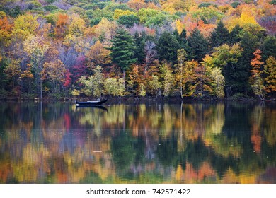 Colorful Canadian fall reflection in Mont-Saint-Bruno National Park