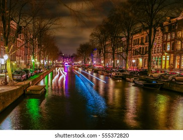colorful canals with historical houses at the Amsterdam light festival Netherlands December 2016