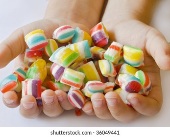 colorful candies in child's hand