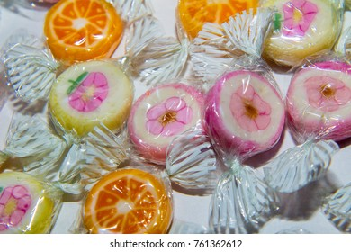 Colorful candies on paper