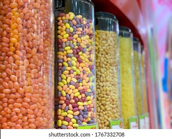 Colorful Candies in plastic tubes in candy shop. Selective focus