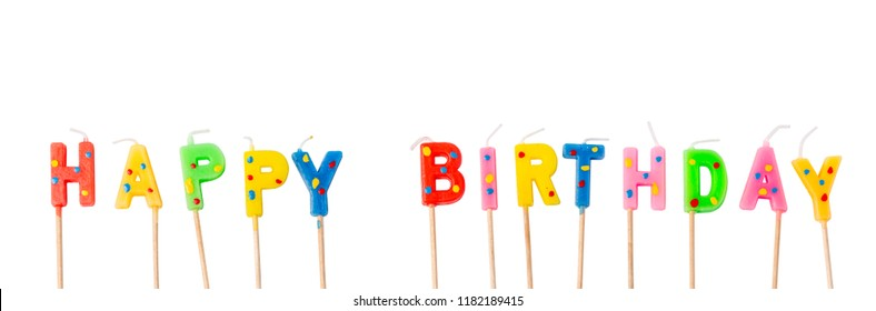 Colorful candles in letters saying Happy Birthday, isolated on white background