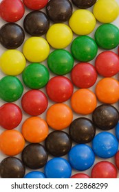 colorful candy in diagonal rows on white