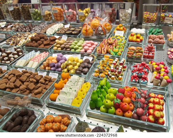 Colorful candy and drinks in the famous Barcelona La Boqueria Market (Mercat de Sant Josep de la Boqueria) in Catalonia, Spain