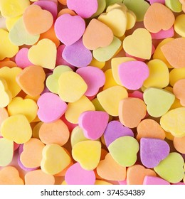 Colorful candy hearts. Background