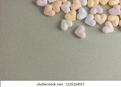 colorful candy hearts on craft background
