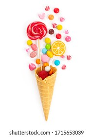 Colorful candy and lollipop in waffle cone isolated on white background.