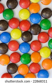 Colorful candy on white background - vertical