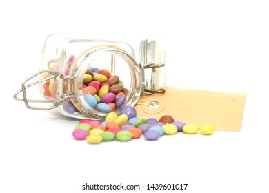 Colorful candy smarties in a jar