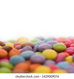 Colorful candy or smarties with a white background