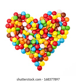 Colorful candy sprinkles heart shape isolated on white background