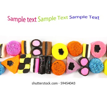 Colorful candy sweets with liquorice and space for text