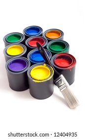 Colorful cans of paint on a white background forming a colorful background with space for copy etc.