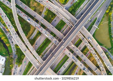 Colorful car on Intersection cross road with vehicle movement aerial view by drone, City transport