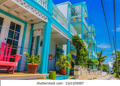 Colorful Caribbean Architecture, Caribbean house exterior with tropical plants and street. Elbow Cay, Hope Town, Abaco, The Bahama.