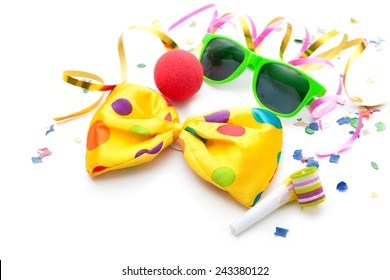 Colorful carnival background with bow tie, sunglasses and streamers