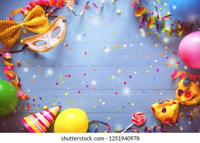 Colorful carnival or birthday background with party items on blue background