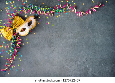 Colorful carnival, festival or birthday background with masks, streamers, candy, confetti and other party items