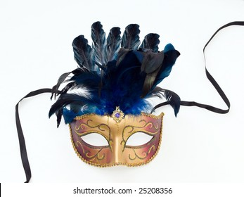 a colorful carnival mask with blue feathers