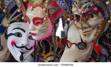Colorful carnival masks on the market in Venice, Italy. Masks were worn in Venice to disguise the wearer from illicit activities:gambling, dancing, affairs or even political assignation