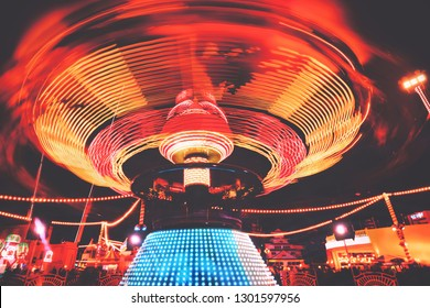 Colorful carosuel in motion at a fun fair. Global Village, Dubai, UAE