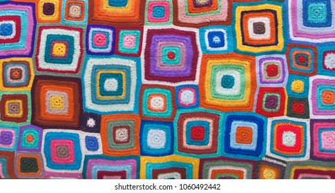 colorful carpet with squares knitted pattern. top view, flat lay