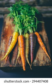 Colorful Carrots on a wooden background