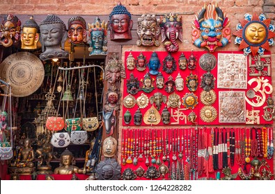 Colorful carved wooden masks and handicrafts on the traditional market in Thamel District of Kathmandu, Nepal