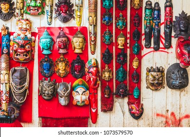 Colorful carved wooden masks are sold on the traditional flea market in Thamel, Kathmandu, Nepal.