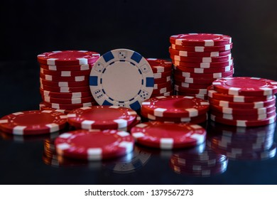 Colorful casino chips on table close up